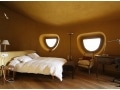 Elegant bedroom. Plaster made from local clay in three layers on top of wooden surface